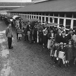 Japanese-Americans line up for a meal.